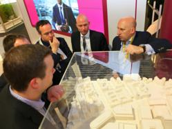 Delegates at MIPIM 2012 looking at plans for Paradise Circus Birmingham